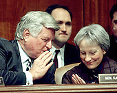 "Washington, DC - (FILE) -- United States Senators Edward M. ""Ted"" Kennedy (Democrat of Massachusetts), Chairman, left, and Nancy Landon Kassebaum (Republican of Kansas), ranking member, right, discuss the nomination of Robert Reich as Secretary of Labor during a hearing of the Senate Committee on Labor and Human Resources in Washington, D.C. on January 7, 1993..Credit: Ron Sachs / CNP"