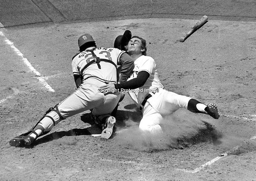 San Francisc Giants Chris Speier is tagged out at home by St.Louis Cardinal catcher Ted Simmons. (1972 photo/Ron Riesterer)