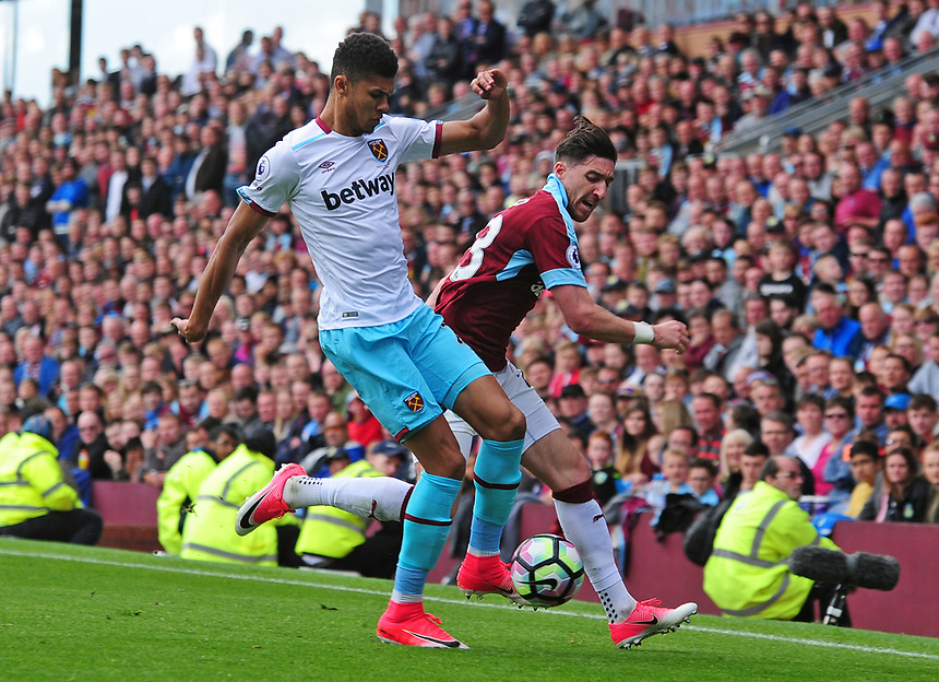 Burnley's Stephen Ward vies for possession with West Ham United's Ashley Fletcher<br /> <br /> Photographer Andrew Vaughan/CameraSport<br /> <br /> The Premier League - Burnley v West Ham United - Sunday 21st May 2017 - Turf Moor - Burnley<br /> <br /> World Copyright &copy; 2017 CameraSport. All rights reserved. 43 Linden Ave. Countesthorpe. Leicester. England. LE8 5PG - Tel: +44 (0) 116 277 4147 - admin@camerasport.com - www.camerasport.com