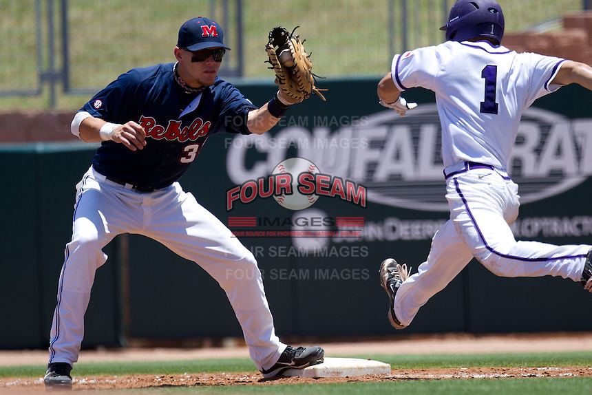 First baseman Matt Snyder #33 of the Ole Miss Rebels in a close play during the NCAA Regional baseball game against the Texas Christian University Horned Frogs on June 1, 2012 at Blue Bell Park in College Station, Texas. Ole Miss defeated TCU 6-2. (Andrew Woolley/Four Seam Images).