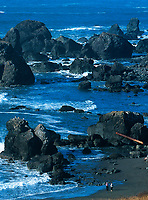 769550161v people photographing the sea stacks and ocean waves at lone ranch state park along the pacific coast of oregon