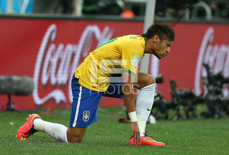 Neymar of Brazil winces as he shows a look of frustration