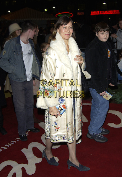 "JENNY AGUTTER.Lemony Snicket's ""A Series of Unfortunate Events"" film premiere, Empire cinema, Leicester Square,.London, 16th December 2004..full length cream coat embroidered patterned white fur trimmed collar cuffs floral.Ref: PL.www.capitalpictures.com.sales@capitalpictures.com.©Phil Loftus/Capital Pictures ..."
