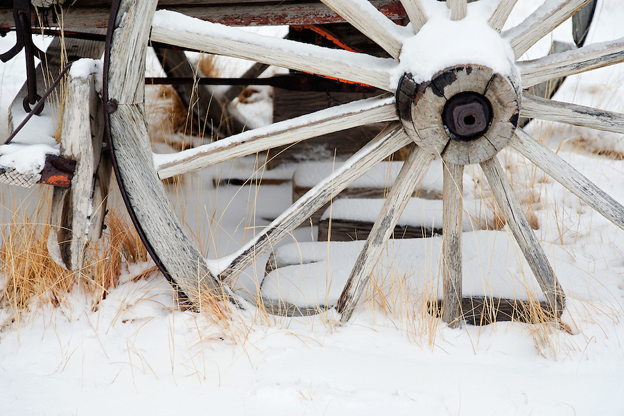 Wagon wheel in snow, Bodie State Historic Park, California, USA