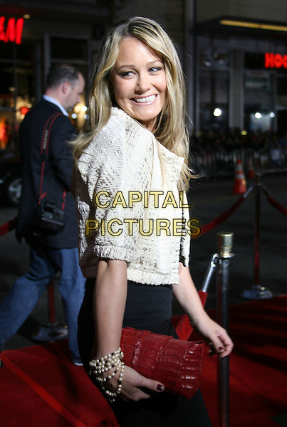 """CHRISTINE TAYLOR.""""Iron Man"""" Los Angeles Premiere held at the Grauman's Chinese Theatre, Hollywood, California, USA,.30 April 2008..half length red clutch bag gold jacket.CAP/ADM/RE.©Russ Elliot/Admedia/Capital PIctures"""