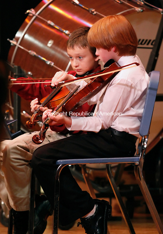 "Torrington, CT-12, May 2010-051210CM10  Hunter Mikata (left), and William Elmendorf, forth graders at Torringford School, play the violin during the All City Orchestra's performance Wednesday evening at  Torrington Middle School.  The Orchestra, directed by Matthew P. Valenti played pieces including, ""Iron Man"", ""Eye of the Tiger"" and a ""Beat it/Thriller"" mix.  The All City Band also performed during the concert, and was led by Director, Joseph L. Campolieta.  --Christopher Massa Republican-American"