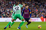 Lionel Andres Messi of FC Barcelona (R) is tackled by Sidnei Rechel Da Silva Junior (L) and William Silva de Carvalho of Real Betis  during the La Liga 2018-19 match between FC Barcelona and Real Betis at Camp Nou, on November 11 2018 in Barcelona, Spain. Photo by Vicens Gimenez / Power Sport Images