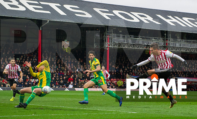 Brentford Sergi Canos strik during the Sky Bet Championship match between Brentford and West Bromwich Albion at Griffin Park, London, England on 16 March 2019. Photo by Andrew Aleksiejczuk / PRiME Media Images.