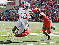Ohio State Buckeyes quarterback Cardale Jones (12) rushes upfield around Maryland Terrapins defensive back Anthony Nixon (20) during the fourth quarter of the NCAA football game at Byrd Stadium in College Park, Maryland on Oct. 4, 2014. (Adam Cairns / The Columbus Dispatch)