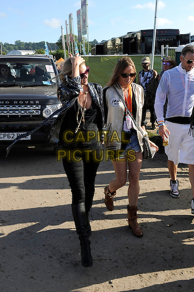 Kate Moss and Stella McCartney backstage at Glastonbury Festival, Worthy Farm, Pilton, Somerset, England. <br /> 29th June 2013<br /> full length sunglasses shades black jacket print shirt jeans denim white brown boots varsity<br /> CAP/MAR<br /> &copy; Martin Harris/Capital Pictures