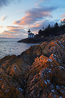 Lime Kiln Point Lighthouse and rocky shoreline, Lime Kiln Point State Park, San Juan Island, Washington, USA