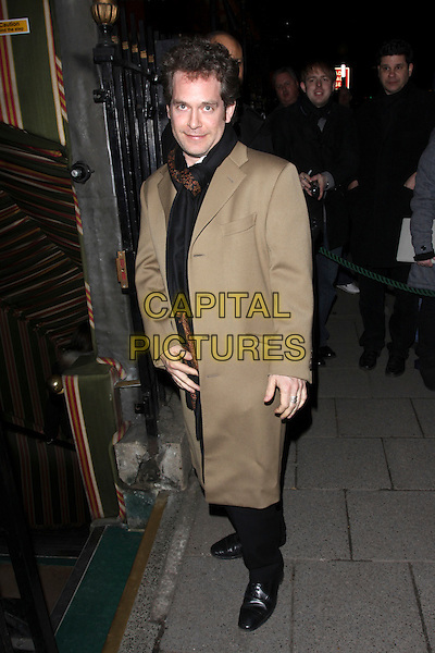 TOM HOLLANDER .The pre-BAFTA party at Annabel's restaurant, London, England..February 20th, 2010.full length beige jacket scarf black trenchcoat trench coat.CAP/AH.©Adam Houghton/Capital Pictures.