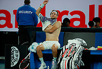 29th January 2020; Melbourne Park, Melbourne, Victoria, Australia; Australian Open Tennis, Day 10; Dominic Thiem of Austria changes shirts on a break during his mens singles semi-final match against Alexander Zverev of Germany