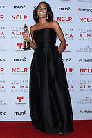 PASADENA, CA - SEPTEMBER 27: Actress Rosario Dawson poses in the press room during the 2013 NCLR ALMA Awards held at Pasadena Civic Auditorium on September 27, 2013 in Pasadena, California. (Photo by Xavier Collin/Celebrity Monitor)