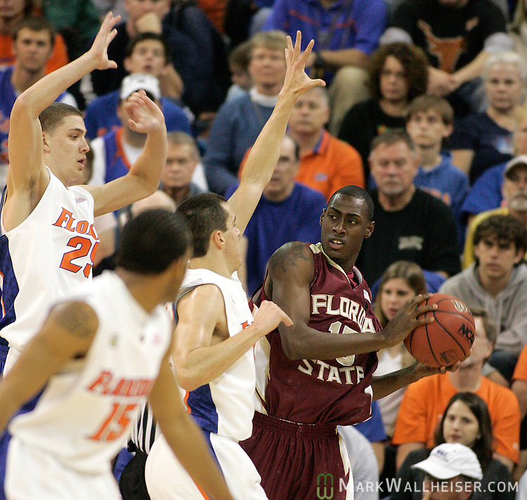 FSU's Casaan Breeden tries to keep the ball away from the Gators in the first half of the FSU game against the Florida Gators at the O'Connell Center in Gainesville, Florida November 23, 2007.   (Mark Wallheiser/TallahasseeStock.com)