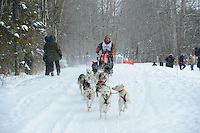 Robert Worden passes by University Lake during the first day of the World Championship Sled Dog Races, a highlight of the 2013 Anchorage, Alaska, Fur Rendezvous.