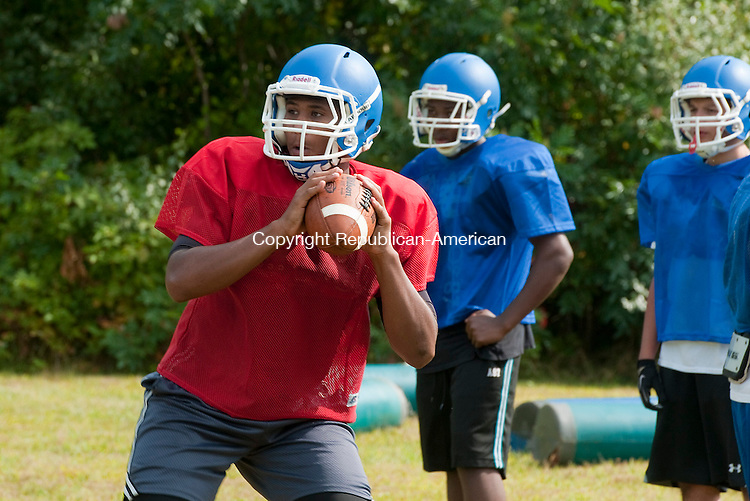 WATERBURY, CT 081614JS04--Crosby quarterback Mike Marshall  throws a pass while goring through drills during practice Saturday at Wallace Middle School in Waterbury. <br /> Jim Shannon Republican-American
