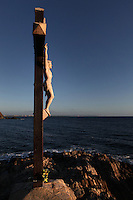 Statue of Christ Crucified, Chapelle St Vincent, 1642, Collioure, France, with the sea in the background. Picasso, Matisse, Derain, Dufy, Chagall, Marquet, and many others immortalized the small Catalan harbour in their works. Picture by Manuel Cohen.