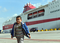 Pictured: A young boy at Piraeus port, Greece Sunday 28 February 2016<br /> Re: Hundreds of migrants have arrived from the Greek islands to Piraeus Port, Greece