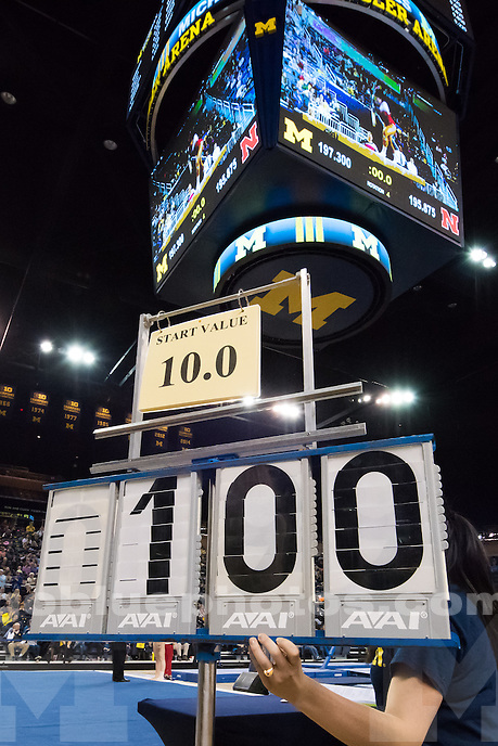 """The University of Michigan women's gymnastics team defeats Nebraska,197.30-195.8, during """"Flip for Autism"""" at the Crisler Center in Ann Arbor, Mich. on January 31, 2015."""
