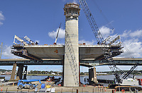 Pearl Harbor Memorial Bridge, New Haven Harbor Crossing Corridor, Interstate 95 in CT. Construction of Connecticut Department of Transportation Contract B as seen on September 9, 2011. New Northbound Span, Progress of the Replacement Bridge. When complete this will be the first Extradosed Bridge in the United States. This sidelong view includes Traveling Formwork and West Tower.