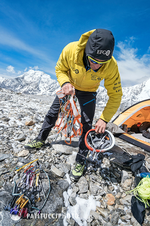 Ueli Steck packing his alpine climbing gear at advance basecamp during the climbing expedition to the 8000 meter peak Shishapangma, Tibet