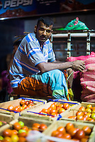Vendor at Dambulla vegetable market, Dambulla, Central Province, Sri Lanka, Asia. This is a photo of a vendor at Dambulla vegetable market, Dambulla, Central Province, Sri Lanka, Asia.