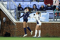 CHAPEL HILL, NC - NOVEMBER 16: Isabel Cox #13 of the University of North Carolina plays the ball in front of Claire Fallon #11 of Belmont University during a game between Belmont and North Carolina at UNC Soccer and Lacrosse Stadium on November 16, 2019 in Chapel Hill, North Carolina.