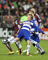 Dax McCarty#13 of FC Dallas and Omar Cummings#14 of the Colorado Rapids go for the ball during MLS Cup 2010 at BMO Stadium in Toronto, Ontario on November 21 2010. Colorado won 2-1 in overtime.