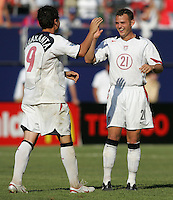 July 24, 2005: East Rutherford, NJ, USA: USMNT forward Brad Davis (21) congratulates Santino Quaranta (9) after he made his penalty kick during the CONCACAF Gold Cup Finals at Giants Stadium.  The USMNT won 3-1 on penalty kicks.