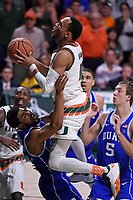 CORAL GABLES, FL - FEBRUARY 25:  Miami guard Bruce Brown (11) puts up a basket over Duke forward Harry Giles (1) late in the second half as the University of Miami Hurricanes defeated the Duke University Blue Devils, 55-50, on February 25, 2017, at the Watsco Center in Coral Gables, Florida. (Photo by Samuel Lewis/Icon Sportswire)