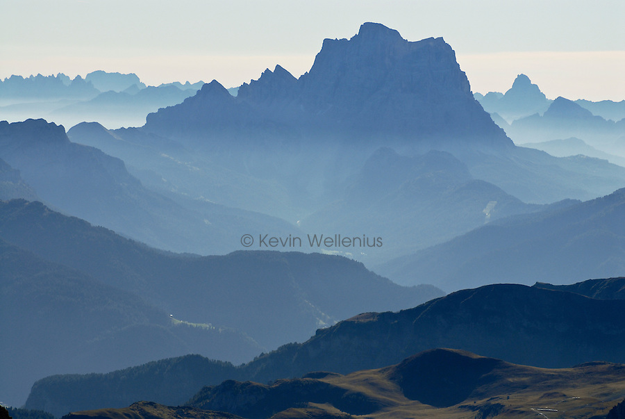 Morning haze reveals the seemingly endless layers of mountain ridges in Italy's Dolomite range, dominated in this view by Monte Pelmo (10,394 feet).
