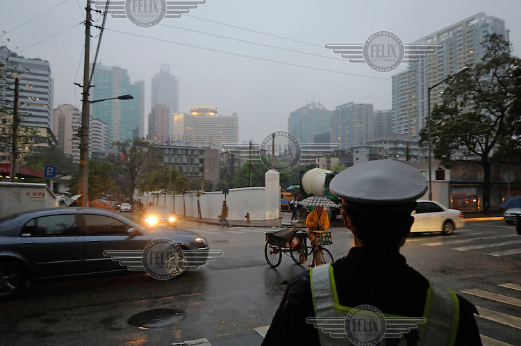 Policeman on duty in the rain on a polluted day.