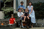 PROFESSOR STEPHEN HAWKING AT HOME WITH HIS YOUNG FAMILY CAMBRIDGE ENGLAND 1981. HIS FIRST WIFE JANE. 1980s UK.<br /> <br /> L-R Seen here with Lucy, eldest son Robert,(behind)   Tim on his knee, wife Jane.