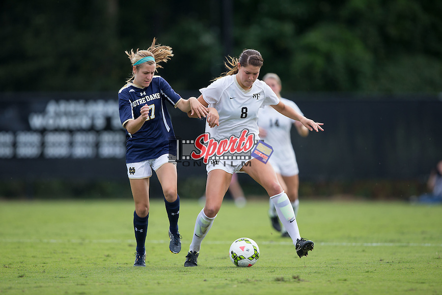 Pilar Torres (8) of the Wake Forest Demon Deacons tries to keep the ball away from Kaleigh Olmstead (27) of the Notre Dame Fighting Irish at Spry Soccer Stadium on September 28, 2014 in Winston-Salem, North Carolina.  The Fighting Irish defeated the Demon Deacons 1-0.   (Brian Westerholt/Sports On Film)
