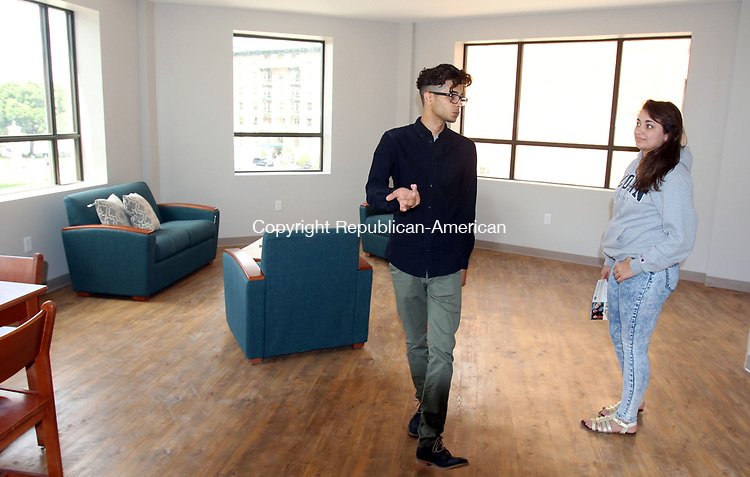 WATERBURY CT. 26 July 2017-072617SV13-Rachel Harbert of Goshen, right,  gets a tour from Efrain Yorres, Student Community Manager, in the new dorms at the Brown Building across the street from UConn Waterbury Wednesday. <br /> Steven Valenti Republican-American