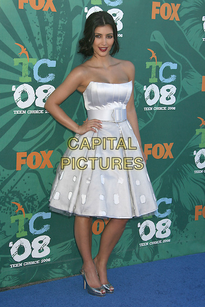 KIM KARDASHIAN.2008 Teen Choice Awards held at the Gibson Amphitheater, Universal City, California, USA, 03 August 2008..full length strapless white prom dress red lipstick belt polka dot silver shoes hand on hip .CAP/ADM/MJ.©Michael Jade/Admedia/Capital Pictures