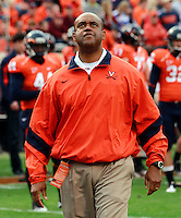 CHARLOTTESVILLE, VA- NOVEMBER 12: Head coach Mike London of the Virginia Cavaliers watches his players warm up before the game against the Virginia Tech Hokies on November 28, 2011 at Scott Stadium in Charlottesville, Virginia. Virginia Tech defeated Virginia 38-0. (Photo by Andrew Shurtleff/Getty Images) *** Local Caption *** Mike London