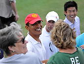 Kailua, Hawaii - December 29, 2008 -- United States President-elect Barack Obama smiles as he shakes hands with well wishers in a crowd gathered beside the 18th hole after he made the putt in Kailua, Hawaii on Monday, December 29, 2008. Obama and his family arrived in his native Hawaii December 20 for the Christmas holiday..Credit: Joaquin Siopack - Pool via CNP