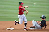Christian Stringer (8) of the Kannapolis Intimidators makes a throw to first base as Cameron Kneeland (9) of the Delmarva Shorebirds slides into second base at CMC-Northeast Stadium on June 7, 2015 in Kannapolis, North Carolina.  The Shorebirds defeated the Intimidators 9-1.  (Brian Westerholt/Four Seam Images)