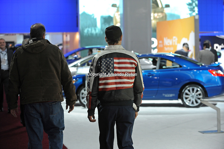 A man wears an American flag leather jacket at the Detroit Auto Show in Detroit, Michigan on January 11, 2009.