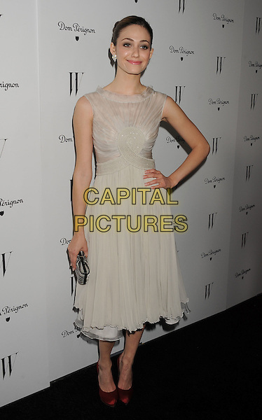 Emmy Rossum.W Magazine's 69th Annual Golden Globe Awards Celebration held at The Chateau Marmont, West Hollywood, California, USA..13th January 2012.full length sleeveless white dress red shoes clutch bag beige hand on hip.CAP/ROT/TM.©Tony Michaels/Roth Stock/Capital Pictures