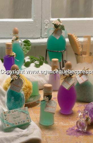 Various bath product (soap, bathing salts , oils and gels) are posed in front of a window in a casual setting<br /> .<br /> This photo can be use for beauty, skin care &  health editorial illustration<br /> <br /> Photo by Pierre Roussel / I Photo.Ca<br /> NOTE : Ajusted and retouched Nikon D-1 Tiff, profiled with QIMAGE, saved as Adobe 1998 RGB                         <br /> 2 sec. f 32 60mm macro + softar