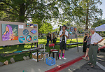 Mural artist Asa Kennedy displays his work during Artown's Opening Night in Reno on Saturday, July 1, 2017.
