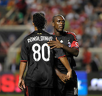 AC Milan midfielder Clarence Seedorf (10) gives Ronaldinho (80) a handshake and pat on the back as Ronaldinho exits the game.  AC Milan defeated the Chicago Fire 1-0 at Toyota Park in Bridgeview, IL on May 30, 2010.