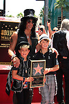LOS ANGELES - JUL 10: Slash, son Cash, son London at a ceremony where Slash is honored with the 2,473rd Star on the Hollywood Walk of Fame on July 10, 2012 in Los Angeles, California