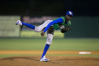 Lexington Legends relief pitcher Yunior Marte (19) follows through on his delivery against the Kannapolis Intimidators at CMC-Northeast Stadium on May 26, 2015 in Kannapolis, North Carolina.  The Intimidators defeated the Legends 4-1.  (Brian Westerholt/Four Seam Images)