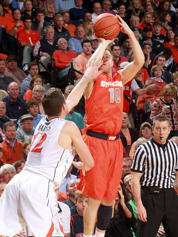 Syracuse guard Trevor Cooney (10) shoots over Virginia guard Joe Harris (12) during an NCAA basketball game Saturday March 1, 2014 in Charlottesville, VA. Virginia defeated Syracuse 75-56.
