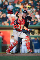 Peoria Chiefs catcher Steve Bean (8) looks for a pop up foul ball in front of umpire Thomas Roche during a game against the Lansing Lugnuts on June 6, 2015 at Cooley Law School Stadium in Lansing, Michigan.  Lansing defeated Peoria 6-2.  (Mike Janes/Four Seam Images)