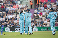 Ben Stokes (England) and Chris Wakes (England) congratulate Jofra Archer (England) on the dismissal of Sheldon Cottrell (West Indies) during England vs West Indies, ICC World Cup Cricket at the Hampshire Bowl on 14th June 2019